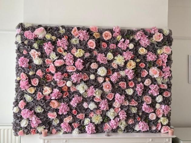 Flower wall in situ featuring grey, pink, peach and lemon blooms