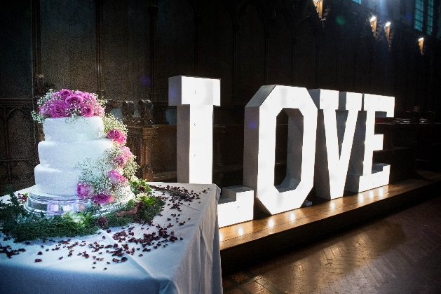 St Augustine's chapel with wedding cake and illuminated love letters