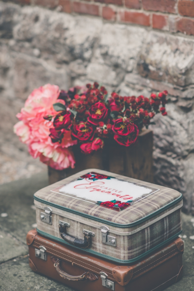 Flowers and tweed suitcases