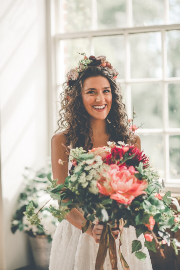 Beautiful boho bride with stunning pink bouquet and flower crown