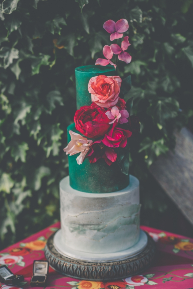 Incredible emerald green cake with bold pink floral decoration