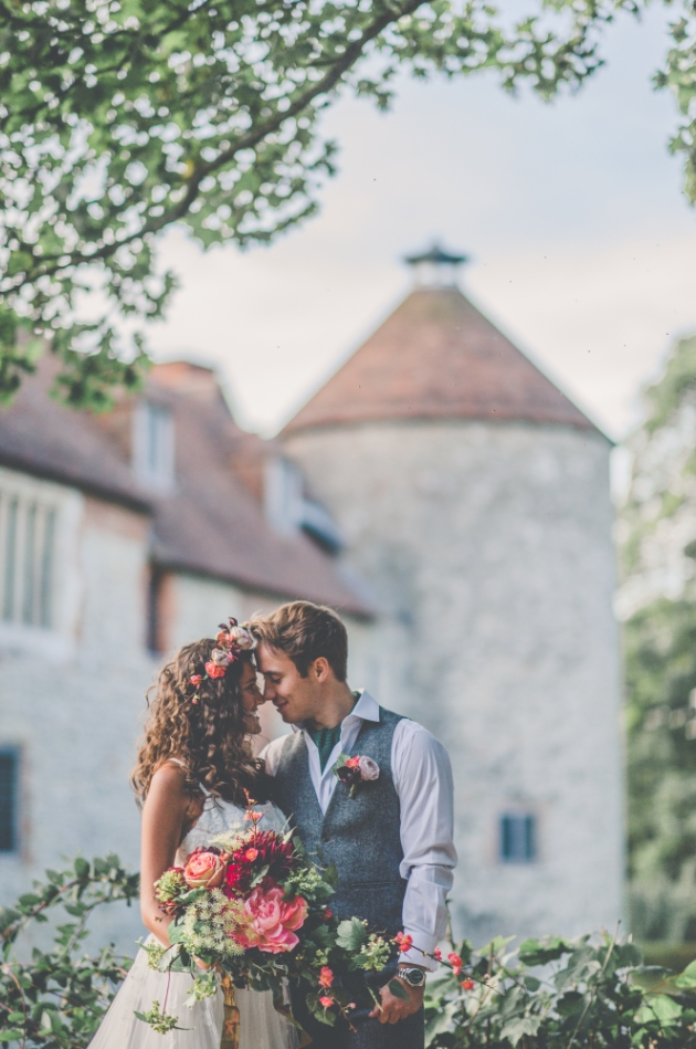 romantic bride and groom with Westenhanger Castle in the background
