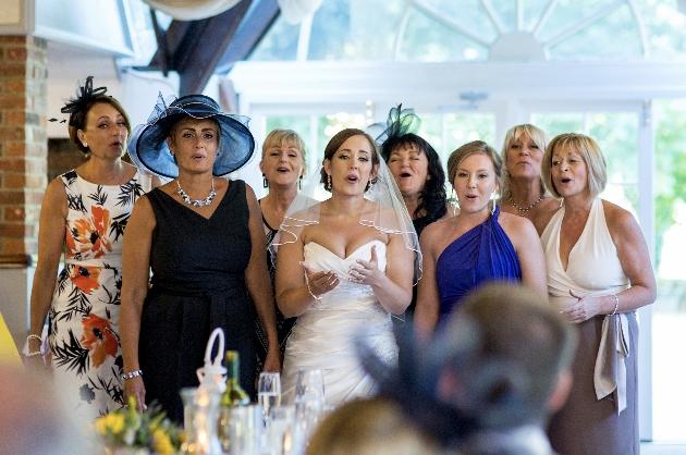 Bride sings with choir