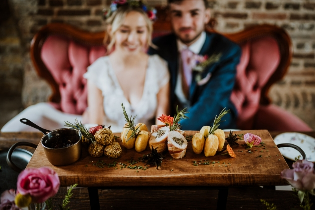 Touchays grazing platter with bride and groom in the background