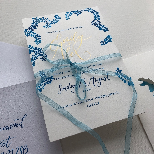 Blue and gold script wedding invitation by The Dandelion Art