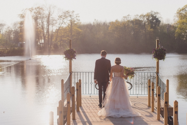 Inn on the Lake, bride and groom on jetty back to camera looking out to lake