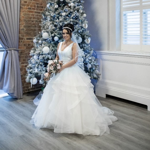 Bride in front of Christmas tree