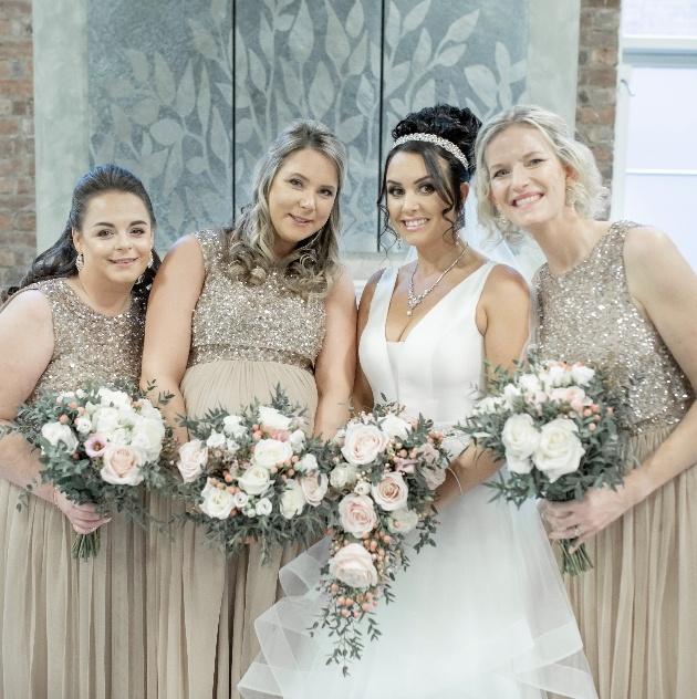 Bride poses with bridesmaids