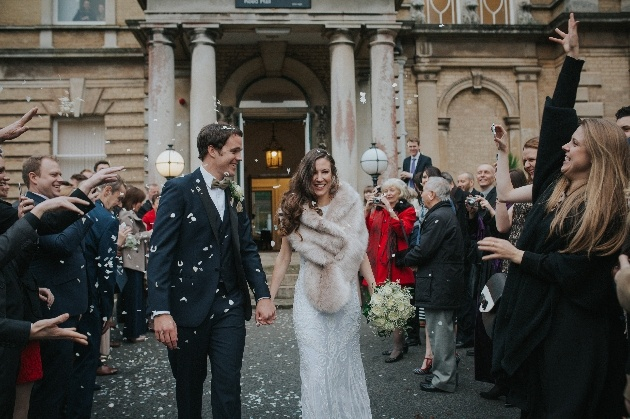 Newlyweds leave their venue in a shower of confetti
