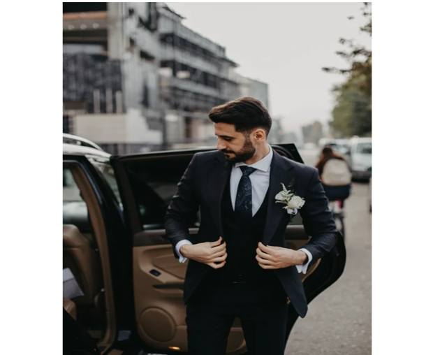 black and white suit on model getting out of car