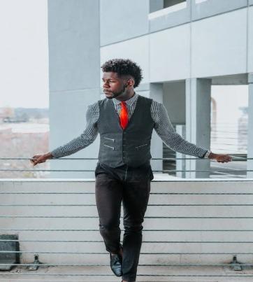man in suit with orange tie