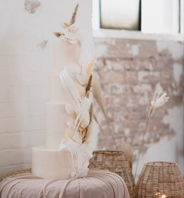 off-set tiers, handcrafted sugar rose, natural tones and edible wafer paper flourishes this cake showcases so many ways to create texture and interest in your cake