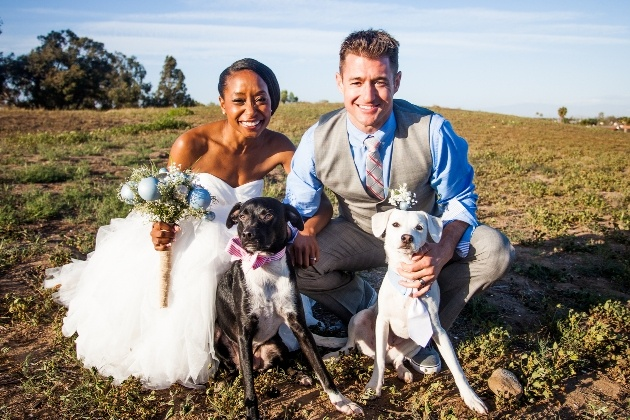 couple in countryside with their two dogs