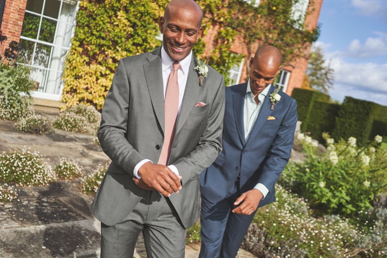 two models in suits by country house