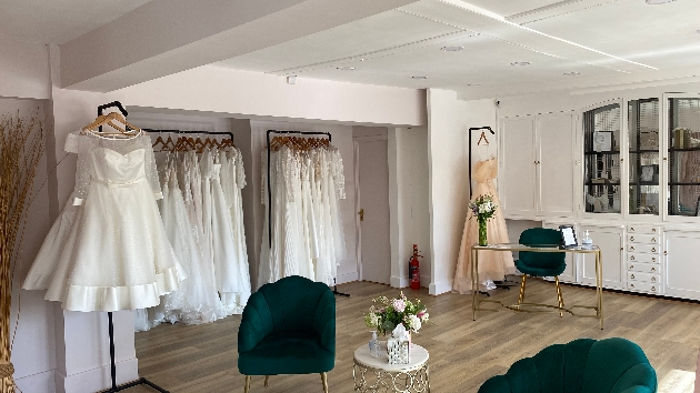 interior of Vicki's Bridal Boutique featuring racks of wedding dresses