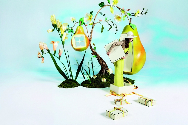 Jo Malone Pear and Freesia campaign imagery woman in yellow standing in box