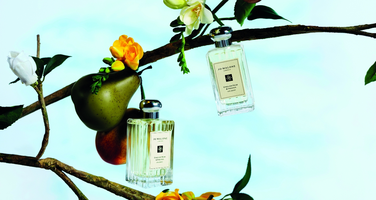 new Jo Malone Pear and Freesia colognes hanging from a pear treee