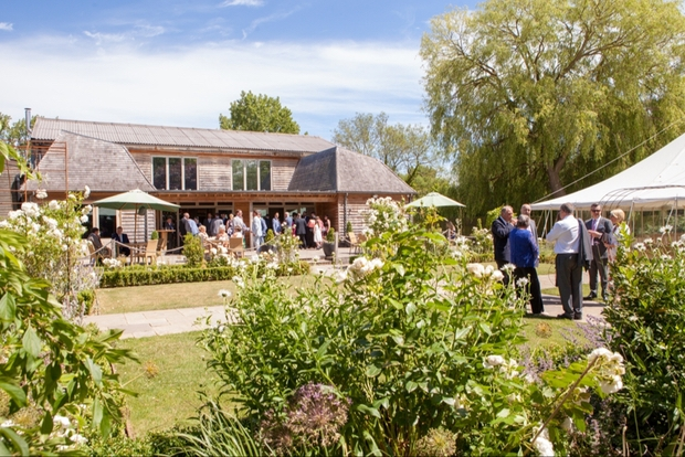 Wedding guests at the back of Houchins barn and gardens